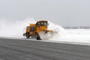 Snow plough clearing the runway at Luton Airport